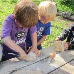 Children working with Soapstone