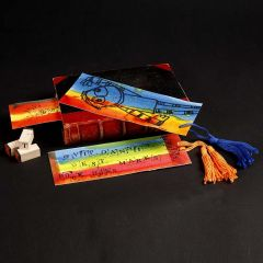 A Book Mark with a stamped Design and a Tassel