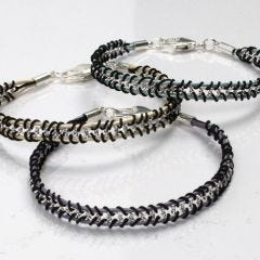 Bracelets braided around a Jewellery Chain and Leather Cords