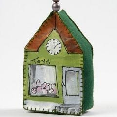 A painted Canvas House  decorated with Beads