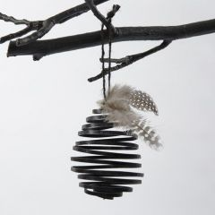 A coil-shaped Egg made from black, flat Aluminium Wire