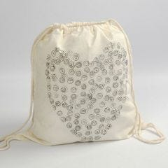 A Shoe Bag with Stamp printed Smilies in a Heart Shape