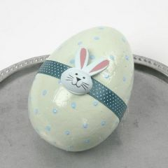 A pastel-painted Egg with a Waist Band and a wooden Sticker
