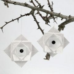 A folded hanging Decoration from Vellum Paper with a Rhinestone