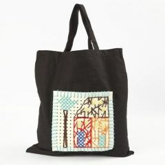A Shopping Bag with Embroidery on a Piece of Felt with Holes
