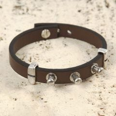 A Bracelet made from a Leather Strap with Metal Studs