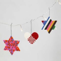 A Heart and Stars made from Nabbi Beads on Peg Boards