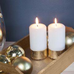 A Pillar Candle with a Gold Imitation Metal Leaf Border