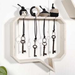 Wooden Keyring Fobs in a Shelf with a Groove