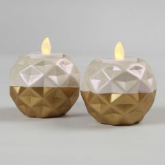 A Candle Holder from white Terracotta painted with Gold and Mother-of Pearl Paint