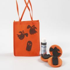 An orange Bag for Halloween decorated with stamped Designs