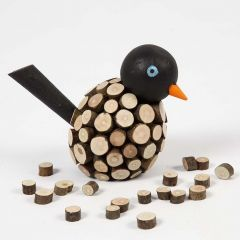 A painted Bird decorated with small wooden Discs with Bark
