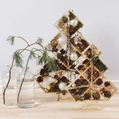 Christmas Trees decorated with Christmas Baubles, Pine Cones, Spruce and Lights