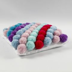A Cushion Cover made from Pom-poms