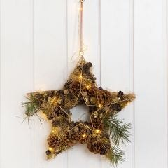 A Metal Star for a Door Decoration decorated with Cones, Lametta etc.