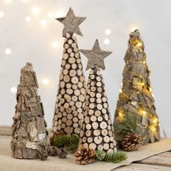 A Christmas Tree from a Polystyrene Cone decorated with Pieces of Bark and wooden Discs