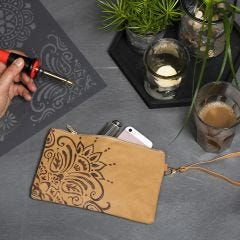 A Faux Leather Paper Clutch decorated with an Ethnic Design using a Pyrography Tool