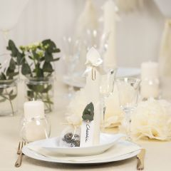 Off-white Table Decorations with Paper Flowers, Balloons, a Napkin folded like a Tower and Place Cards