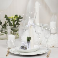 White Table Decorations with Paper Flowers, Balloons, a Napkin folded like a Tower and Place Cards