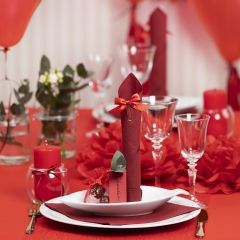 Red Table Decorations with Paper Flowers, Balloons, a Napkin folded like a Tower and Place Cards