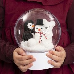 A transparent Bauble on a Stand with a Snowman, a Penguin and a Polar Bear inside