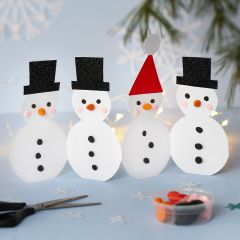 A Row of Card Snowmen decorated with Silk Clay