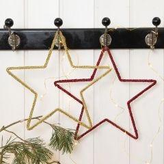A crocheted Christmas Star on a Metal Star Frame