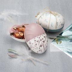 A two-part papier-mâché egg decorated with Plus Color craft paint and deco foil