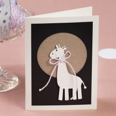 An invitation with a punched-out giraffe