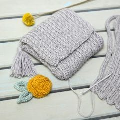 A Purse made from knitted Tube decorated with a Tassel