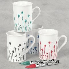 Porcelain mugs decorated with flowers drawn with glass & porcelain markers