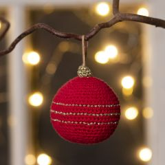 A Christmas bauble crocheted from cotton yarn