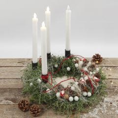 An Advent wreath decorated with natural materials and LED candles