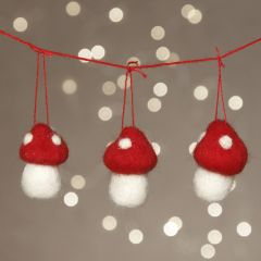 A garland with needle-felted toadstools