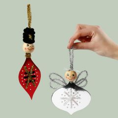 An angel and a nutcracker made from cross stitch card and pipe cleaners