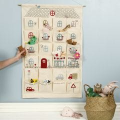 A hanging organiser decorated like a playhouse with iron-on foil