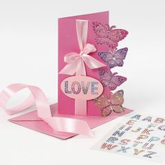 A greeting card decorated with diamond sticker butterflies