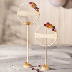 Table decorations from a bamboo ring decorated with dried flowers