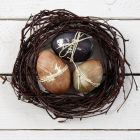 Natural Eggs with Decorative Colouring and a Paper String Waistband