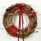 A natural Wreath with red Decorations
