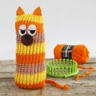 A knitted, stripy Cat made on a Knitting Loom