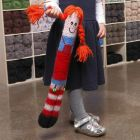 A long knitted and felted cuddly Doll