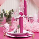Light red Table Decorations with Paper Flowers, Balloons, a Napkin folded like a Tower and Place Cards
