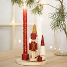 A Candlestick decorated with a Nutcracker Figure, Christmas Trees and mini Glass Beads