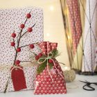 Christmas Gift Wrapping with a Twig and artificial Berries