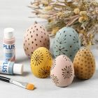 Stained wooden eggs decorated with a pyrography tool