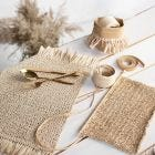 Place mats knitted from paper raffia with tassels