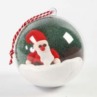 A Decorative Bauble with a Landscape and a Figure inside