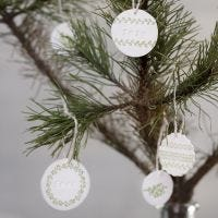 Hanging decorations made from self-hardening clay with stamped designs