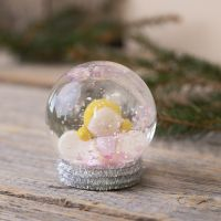 A snow globe with an angel made from Fimo